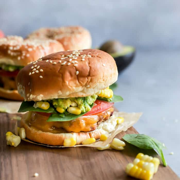 cheddar turkey burger with guacamole and corn toppings