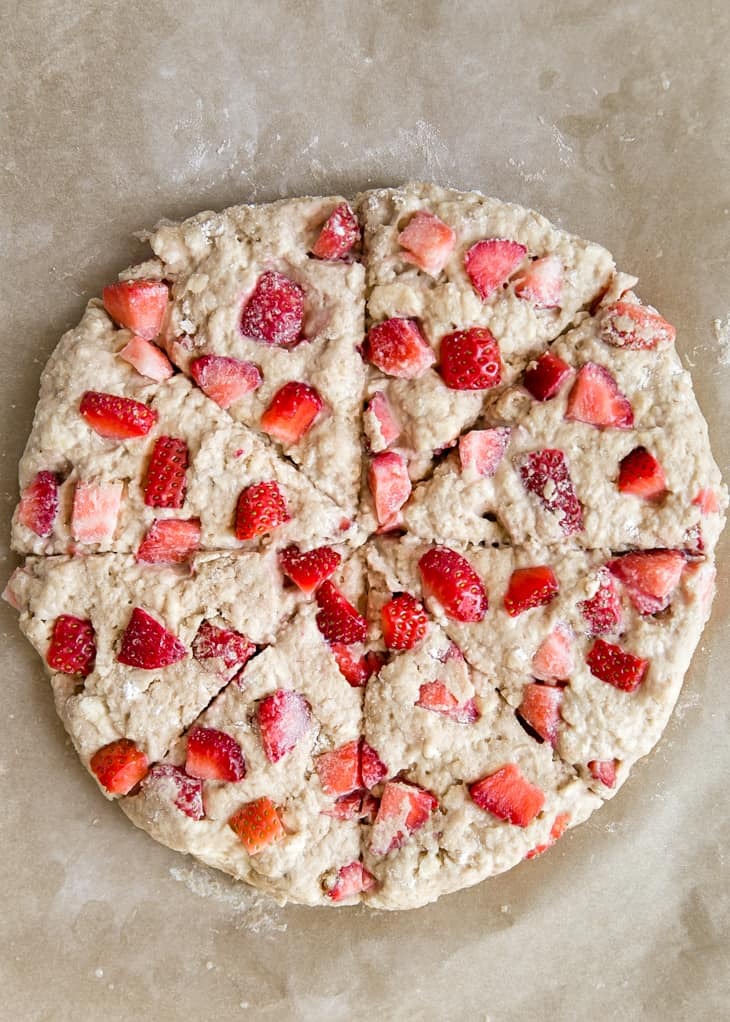 round strawberry scone dough cut with triangle slices