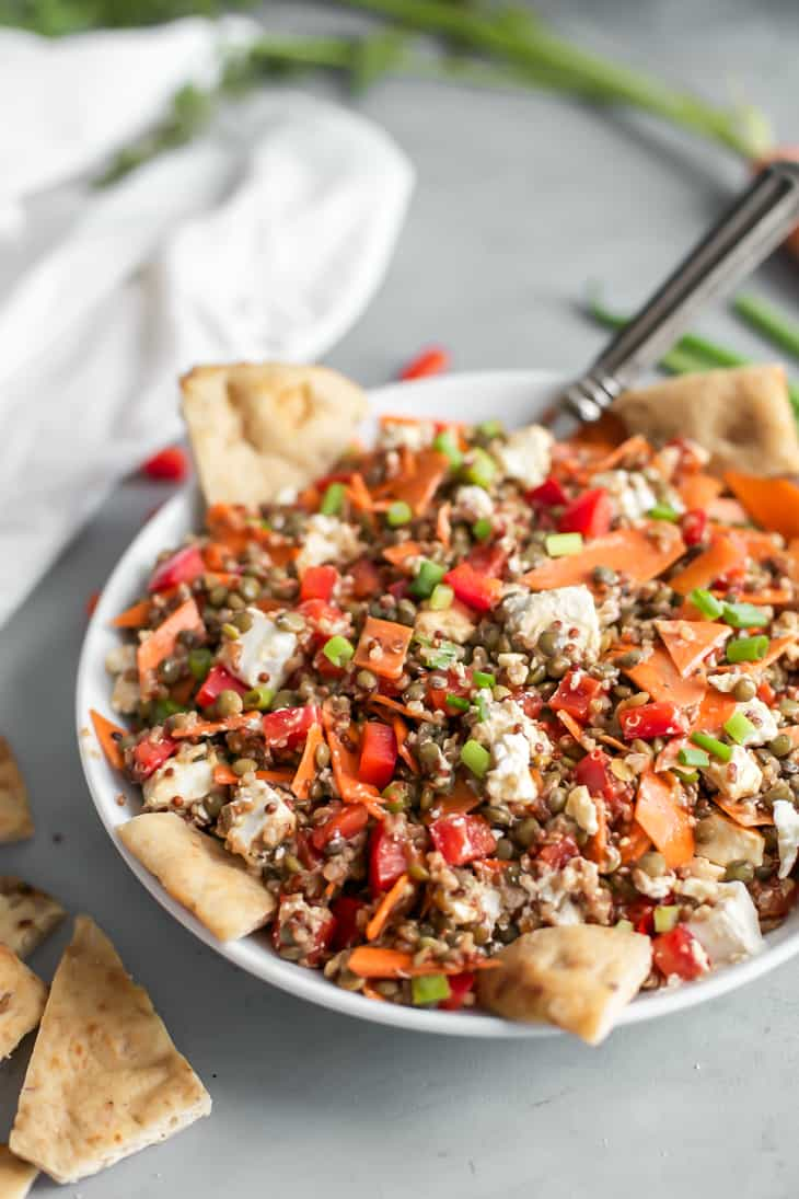 quinoa lentil salad with carrots, red pepper and pita chips in bowl