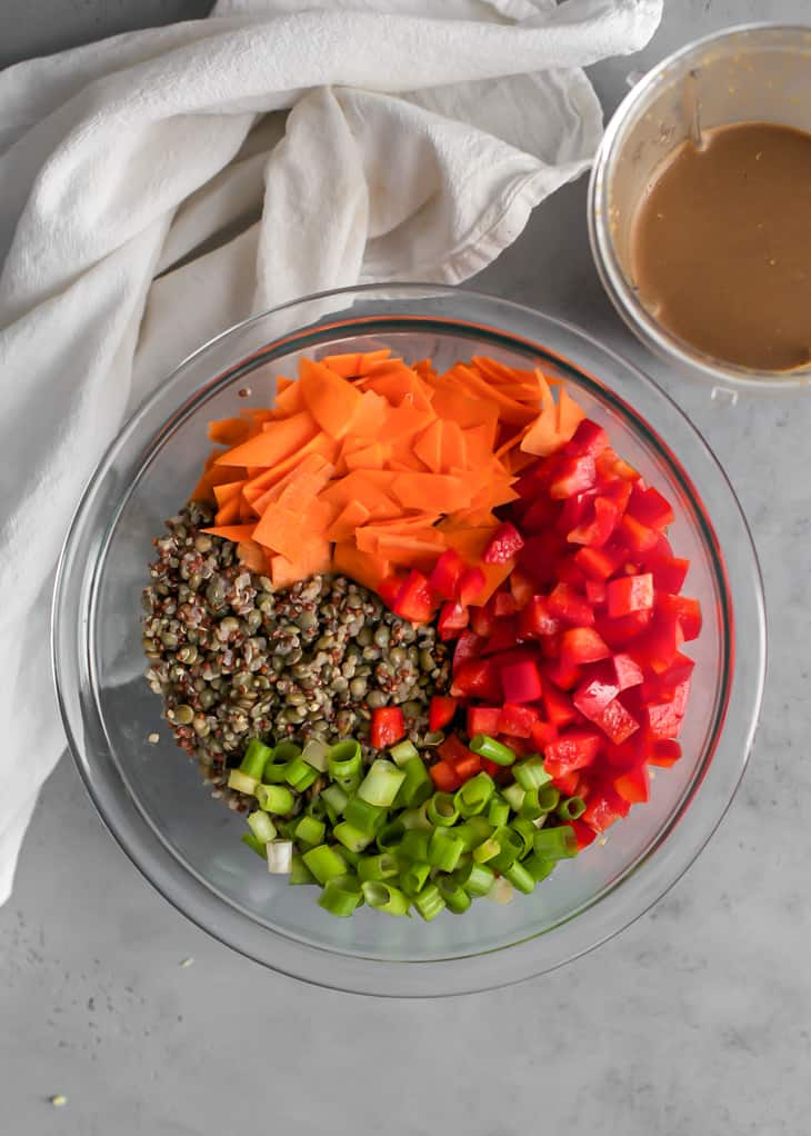 carrots, red bell pepper, scallions, and quinoa in glass bowl