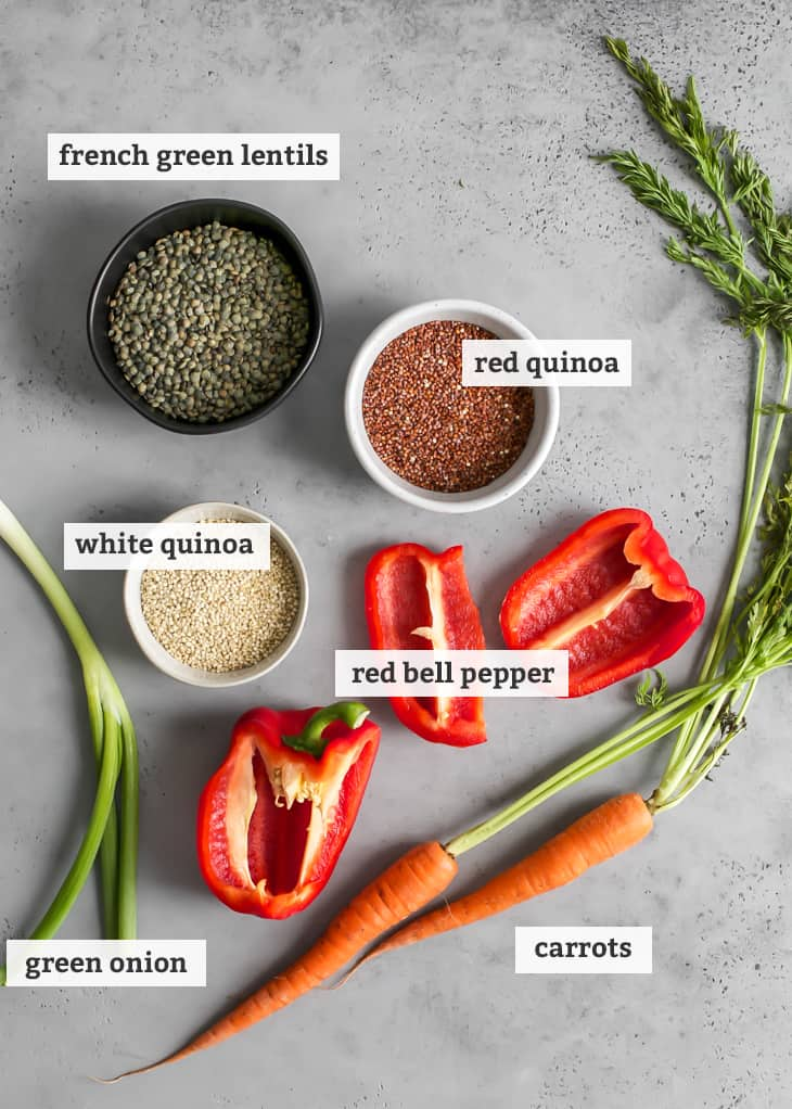 french green lentils, red quinoa, white quinoa, red bell pepper, carrots and green onion on gray board with text labels