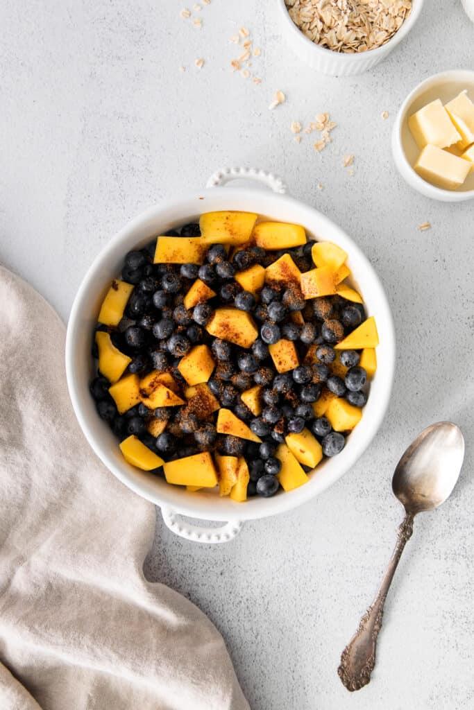blueberry and mango in round white baking dish