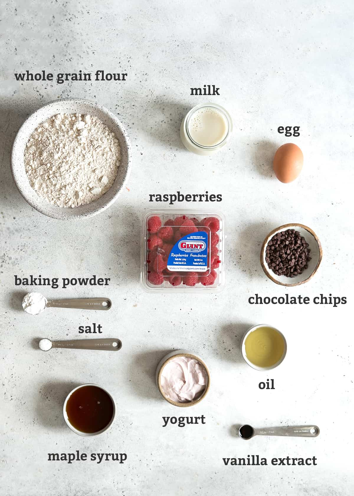 ingredients labeled on board; whole grain flour, milk, egg, raspberries, baking powder, salt, chocolate chips, oil, yogurt, maple syrup, vanilla extract