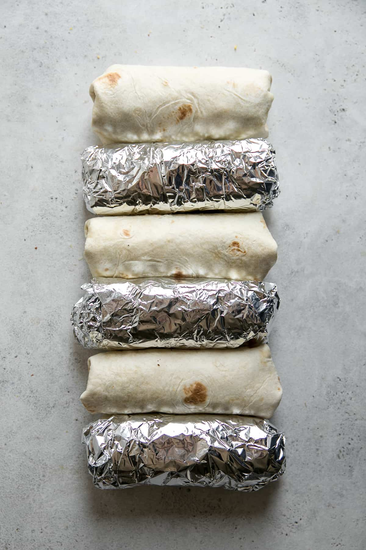 breakfast burritos wrapped in tin foil
