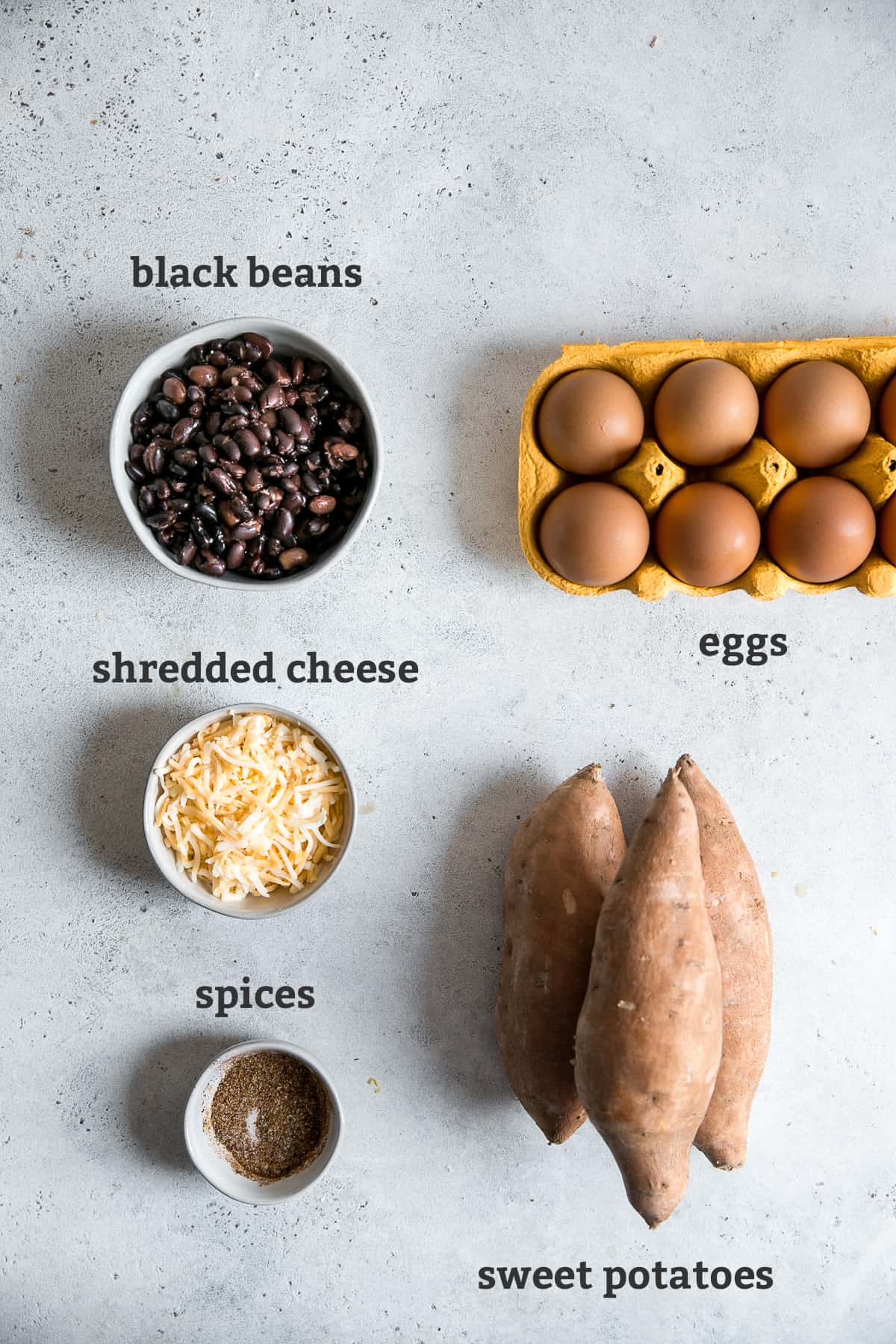 black beans, cheese, sweet potatoes, and eggs on board with text by each ingredient