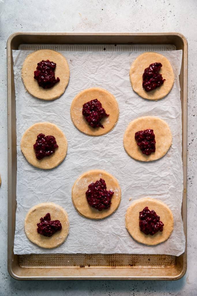 blackberry jam on pie dough, on baking sheet