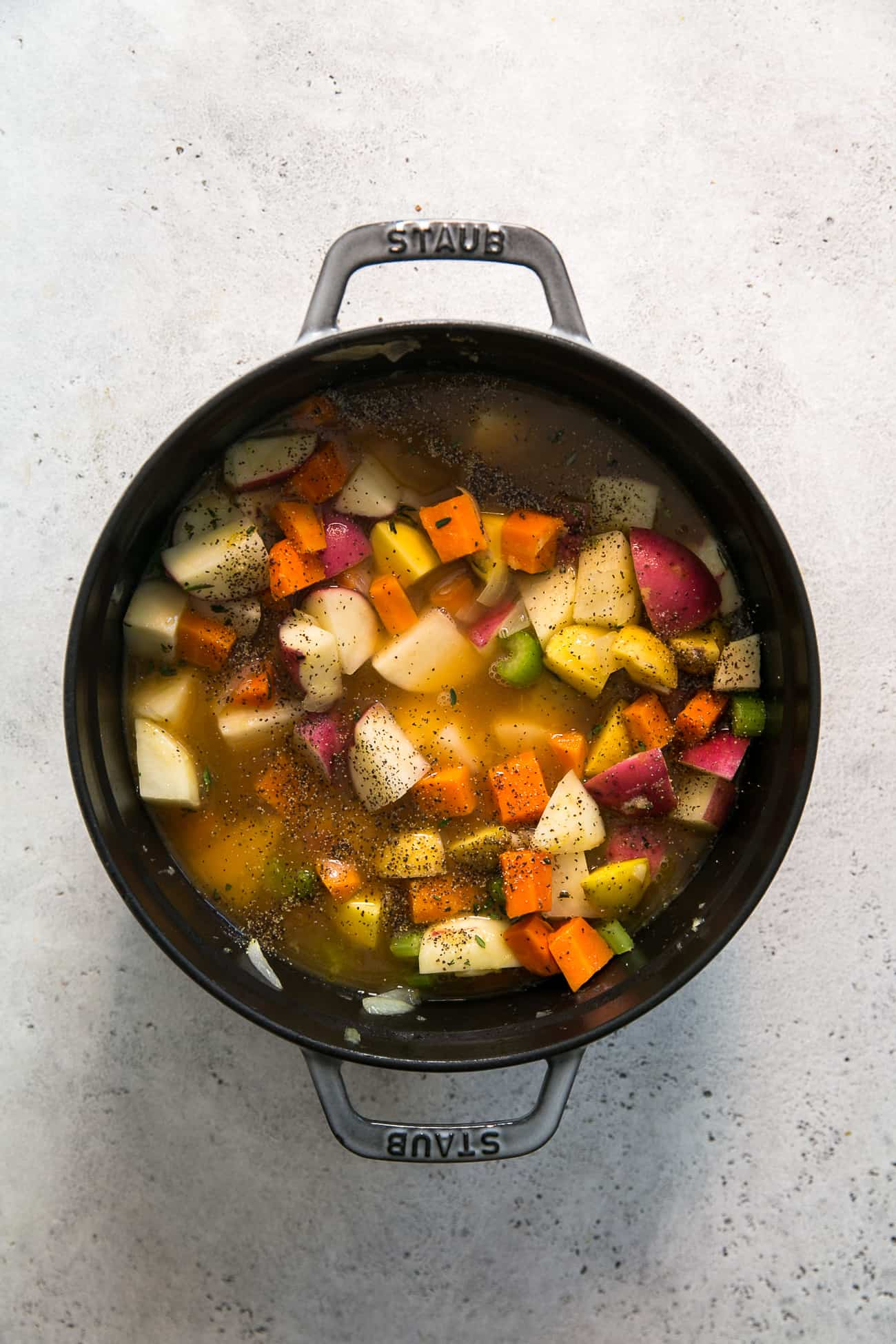 staub pot with ingredients for potato soup