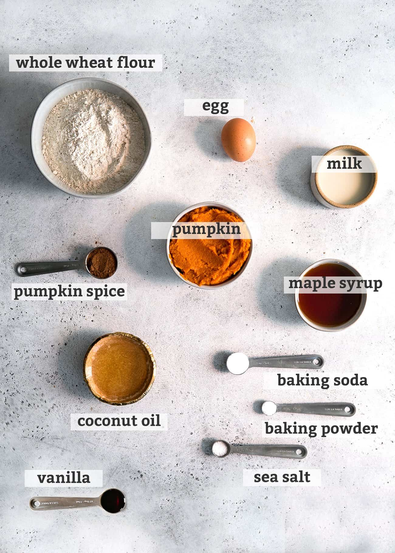 ingredients on board for pumpkin muffins, in spoons and bowls